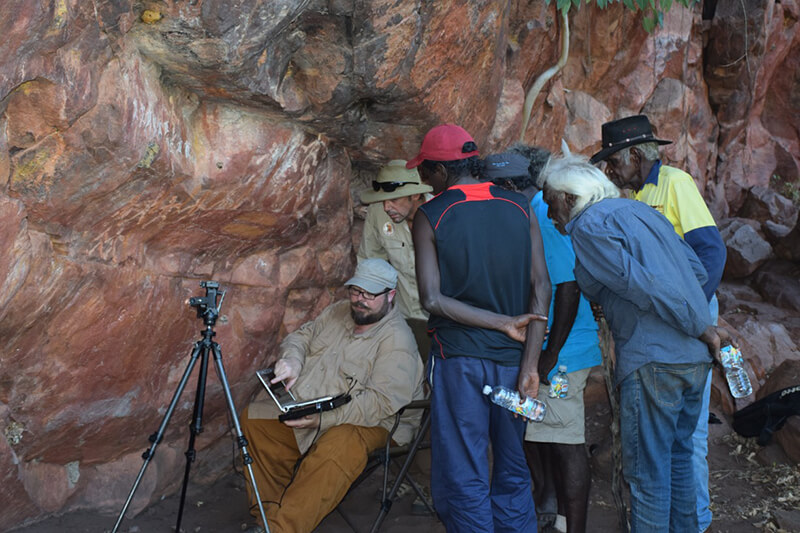 Custodians examining images taken of rock art