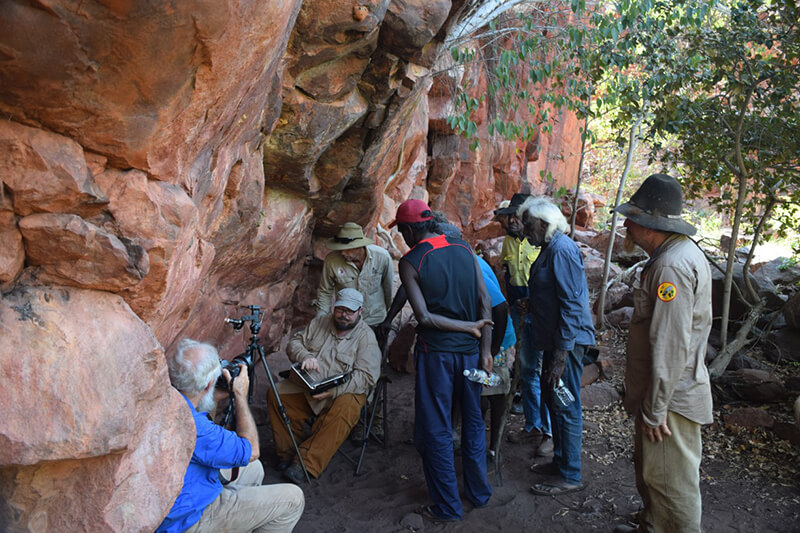 Custodians and Rangers examining the images of the rock art pigment