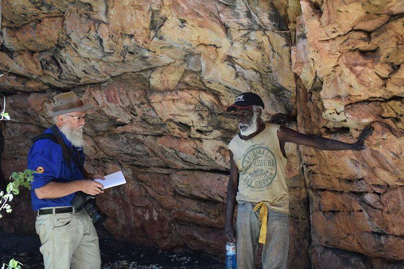 Custodian and Project Consultant discussing the rock art at West Lost City