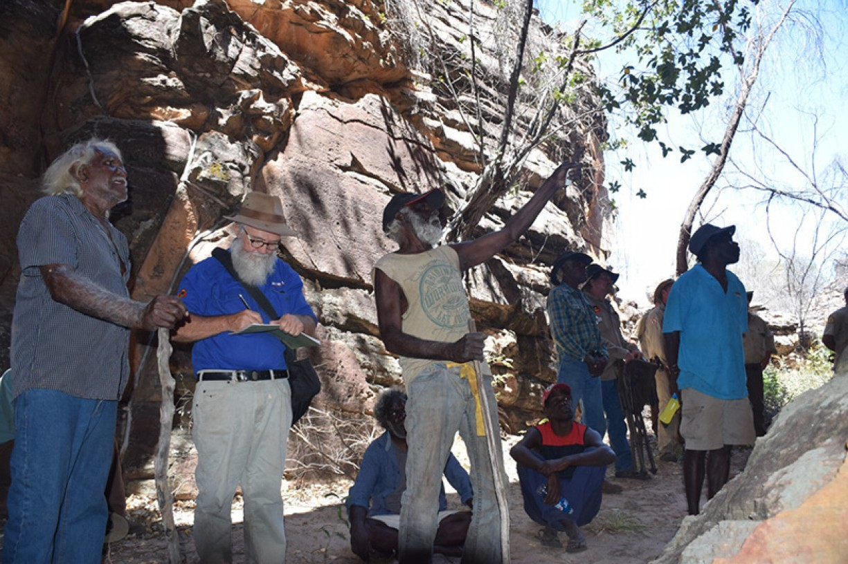 Custodians discussing the rock art at West Lost City
